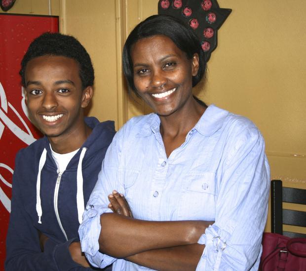 Shegitu Kebede (right) with Neyat Tafer, Frewoini Haile's nephew. Photo: Courtesy of TC Daily Planet