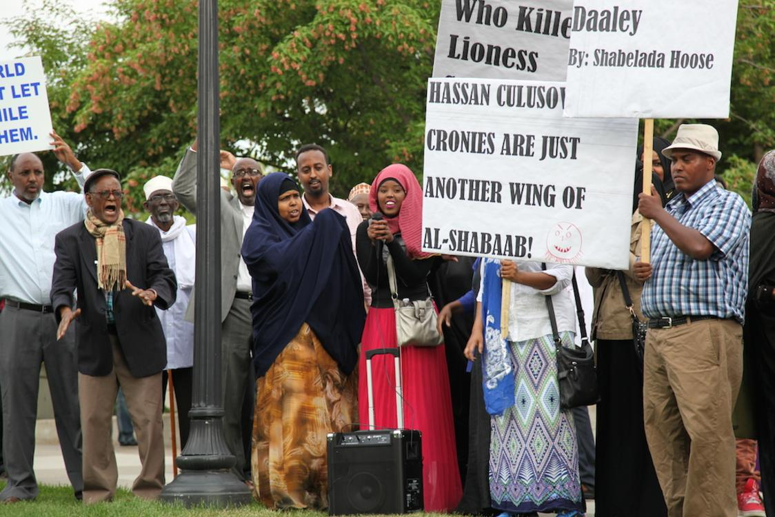 Somali-Americans in the Twin Cities carry placards as they protest the visit of president Hassan Sheikh Mohamud of Somalia at the Northrop Auditorium on August 9 2014. Photo: Christina Cerruti/TC Daily Planet