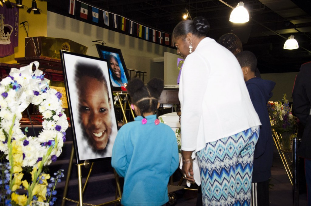 Mourners stare at the smiling photo of 10-year-old Barway Collins during an emotional funeral service at Shiloh Temple International Ministries in Minneapolis on May 2, 2015, exactly three weeks after his body was found on the Mississippi River on Saturday, April 11. His father, Pierre Collins, was taken into custody two days after Barway was found and charged with the murder of his son. Photo: Kaamil Haider/Mshale