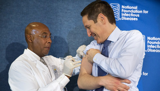 Centers for Disease Control and Prevention Director Dr. Tom Frieden, right, receives a flu shot from nurse B.K. Morris during an event about the flu vaccine, Thursday, Sept. 17, 2015, at the National Press Club in Washington.  Photo: Jacquelyn Martin/AP