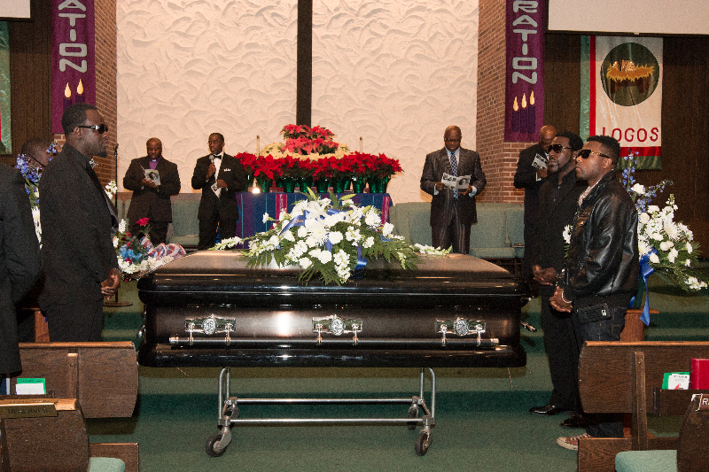 Friends of the late Henry McCabe guarded each corner of the casket during his funeral at the Brooklyn United Methodist Church in Brooklyn Center, Minnesota on December 19, 2015. To her immediate right is daughter Yve. The late McCabe's body was discovered at Rush Lake on November 2, 2015 after missing for almost a month. Photo: Courtesy of Liberian Brothers and Sisters Keepers Organization (LIBASKO)