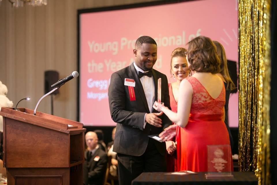 Ghana-born Godson Sowah receives the Young Professional of the Year Award from the Saint Paul Area Chamber of Commerce. Sowah is an Advisory Manager at Ernst & Young and serves as the chairman of the annual Mshale African Awards Judges panel. Photo: Courtesy St. Paul Area Chamber of Commerce