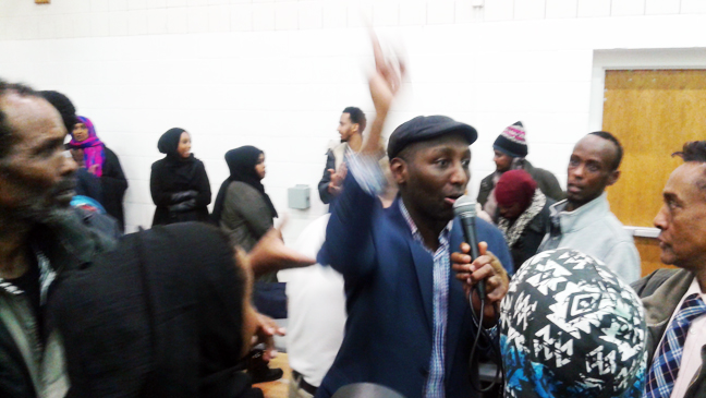 Mohamud Noor of the Confederation of Somali Community in Minnesota declares victory in the sub-caucus in his battle for the Democratic nomination for Minnesota House District 60B against fellow Somali Ilhan Omar who came in second and the incumbent Phyllis Kahn who trailed in third place. He won the precinct. Photo: Faiza Abbas Mahamud