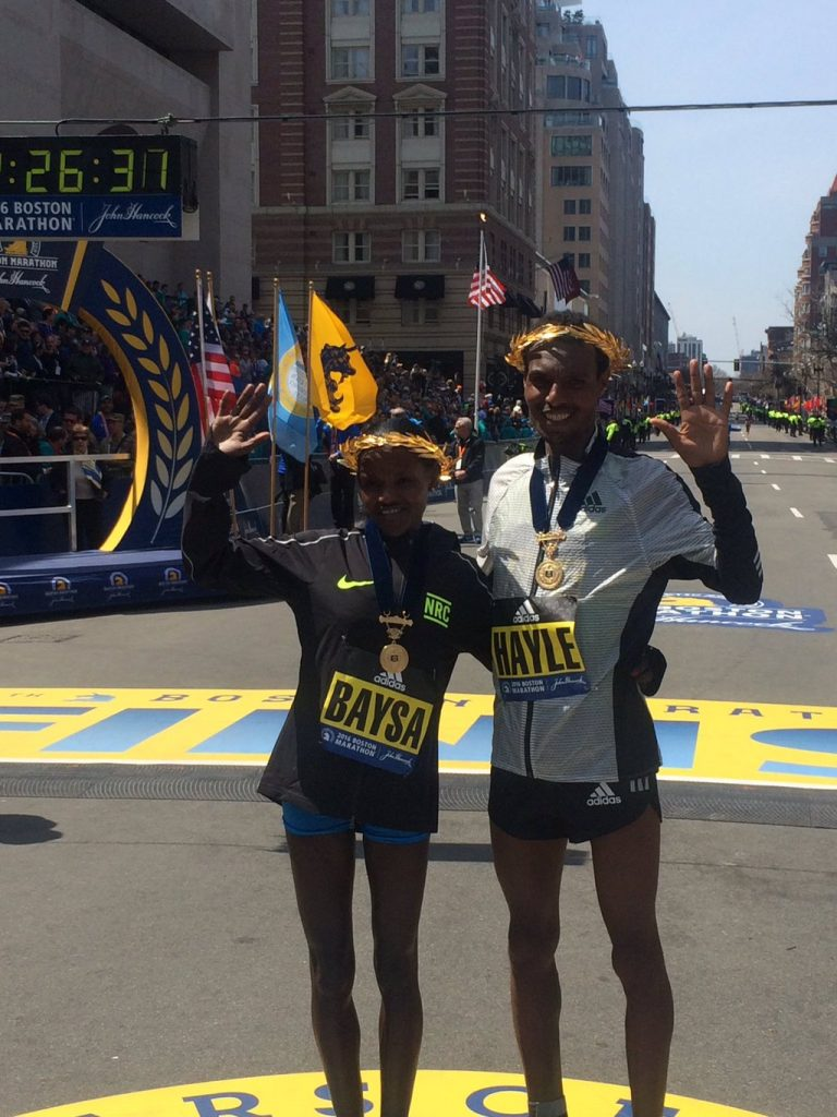 Atsede Baysa, left, and Lemi Berhanu Hayle, both of Ethiopia, moments after they won the women's and men's divisions of the 120th Boston Marathon on Monday, April 18, 2016, in Boston. Photo: Courtesy Boston Marathon