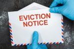 Eviction Notice Red Letters Envelope Medical Gloves COVID-19_0